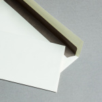 Creme Couverts mit Kraftpapierfutter